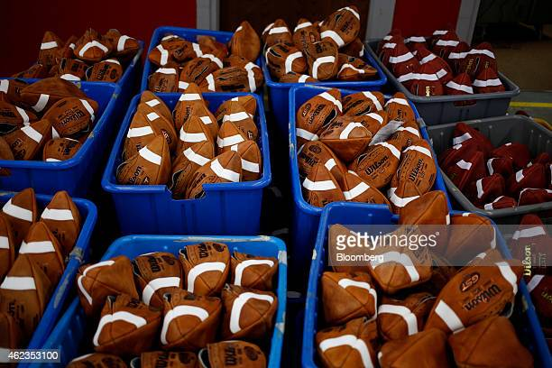 Bins of footballs sit on the floor before being laced up at the Wilson Sporting Goods Co factory in Ada Ohio US on Monday Jan 26 2015 Super Bowl XLIX...