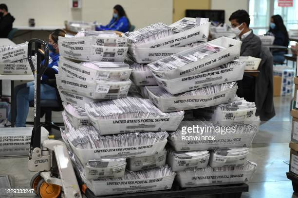 Bins of mail-in ballots await distribution to workers sorting the envelopes for the US presidential election at the Los Angeles County Registrar...