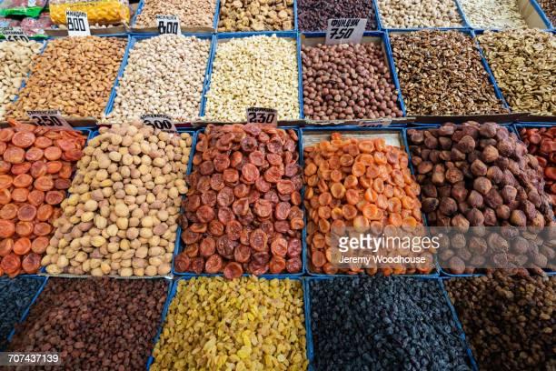 bins of nuts and dried fruit at bazaar - bisjkek stockfoto's en -beelden