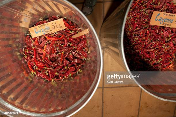 Bins of Sun-Dried Guajillo Chili Peppers and Sun-Dried Cayenne Peppers