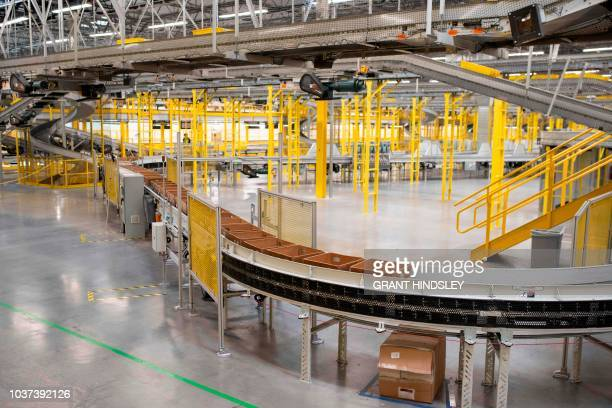 Bins return to stations to be filled with goods are seen during a tour of Amazon's Fulfillment Center September 21 2018 in Kent Washington