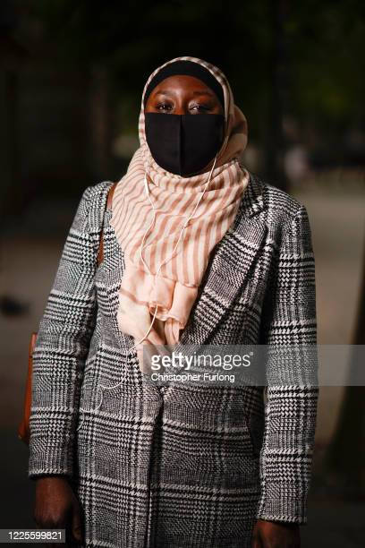Binta poses wearing her face mask as she shops for essentials on May 18, 2020 in Bolton, United Kingdom. People are beginning to get back to work and...