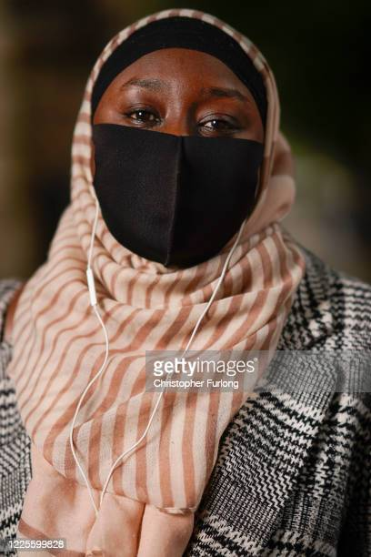 Binta poses wearing her face mask as she shops for essentials on May 18 2020 in Bolton United Kingdom People are beginning to get back to work and...