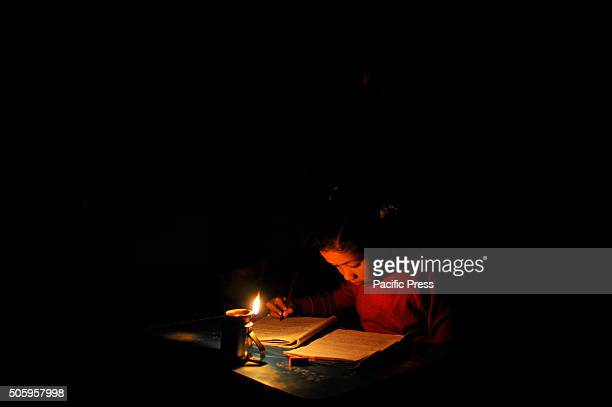 BHAKTAPUR NEPAL KATHMANDU NP NEPAL Binu Manandhar 10yrs old studying in grade 4 doing her daily homework with the help of an oil lamp at Bhaktapur...