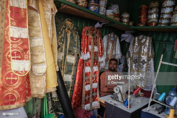 Binyam a local artisan prepares clothing for Priest and Deacons of the Ethiopian Orthodox Church ahead of the January 7th Gena/Orthodox Christmas...