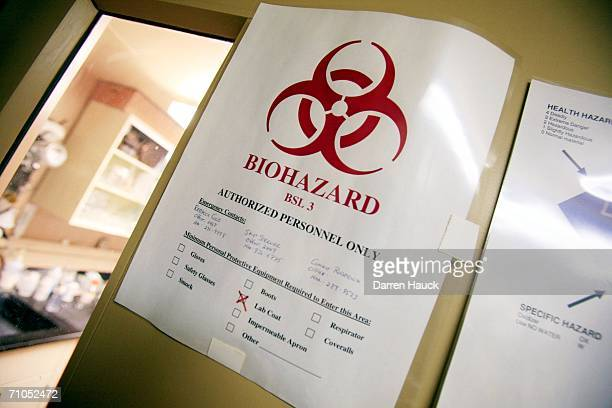 Bio hazard warning signs line the walls at the USGS National Wildlife Health Center May 25 2006 in Madison Wisconsin The USGS in Madison is on the...