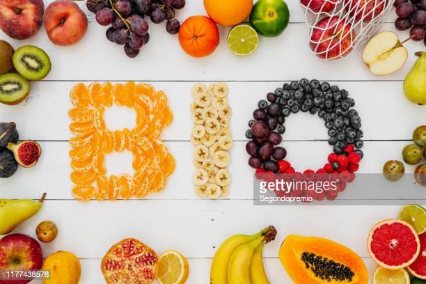 bio lettering on fruit table - biología fotografías e imágenes de stock