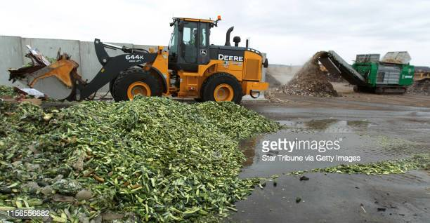 Biodegradable paper and food waste is loaded into slow speed grinder Monday at the Organics Recycling Facility in Prior Lake, MN. Twelve weeks later...
