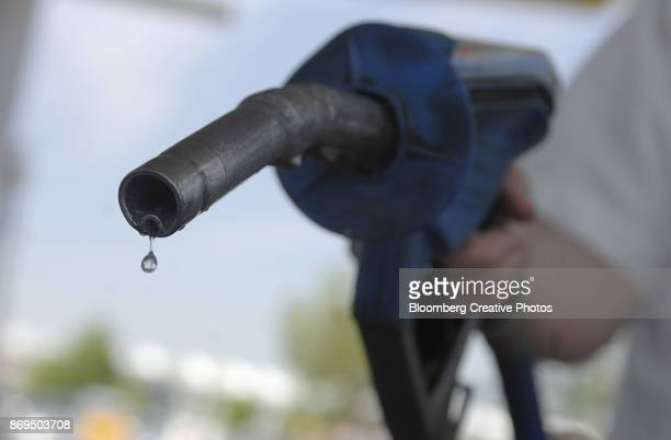 bioethanol fuel drips from a pump - fossil fuel stock photos and pictures