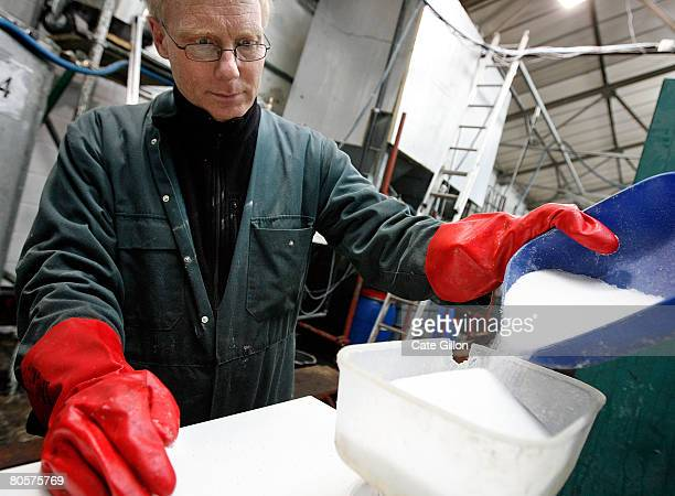 Biofuel producer Kees 't Hooft weighs sodium hydroxide to use in a mixing tank during the creation of biodiesel on April 9 2008 in London England The...