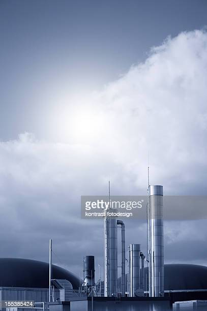 Biogas energy plant against dramatic sky, Germany.