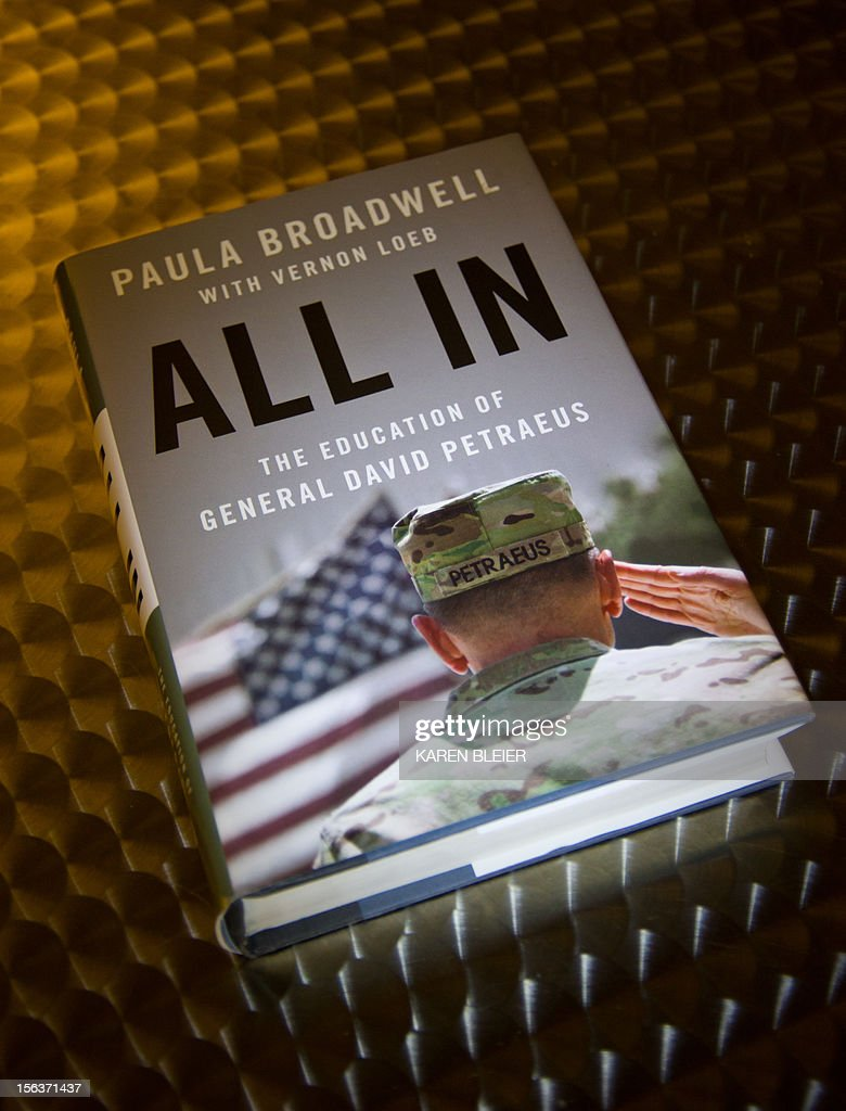 "Biographer Paula Broadwell's book 'All In: The Education of General David Petraeus,' is seen on a desk in Washington,DC on November 14, 2012. Petraeus' surprise resignation as CIA director resulting from an extramarital affair has now spiraled into a complicated story of infidelity, intrigue and politics. Petraeus' admission of an extramarital affair quickly led to his biographer, Paula Broadwell, and an examination of her relationship with the decorated war hero. The length of the FBI's investigation of ""menacing"" emails sent to Petraeus' family friend Jill Kelley, and the timing of the announcement of his departure from the Obama administration fueled conspiracy theories. Then Gen. John Allen, Petraeus' successor as military commander in Afghanistan, was embroiled in the scandal, accused by US officials of sending ""inappropriate"" emails to Kelley. AFP PHOTO/Karen BLEIER"