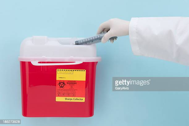 biohazard box and syringe disposal/close-up and isolated - toxic waste stock pictures, royalty-free photos & images