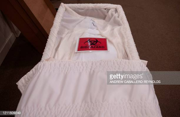 TOPSHOT A biohazard sign is seen on the body of a COVID19 victim in a casket at the Stauffer Funeral Homes in Frederick Maryland on May 1 2020 Local...
