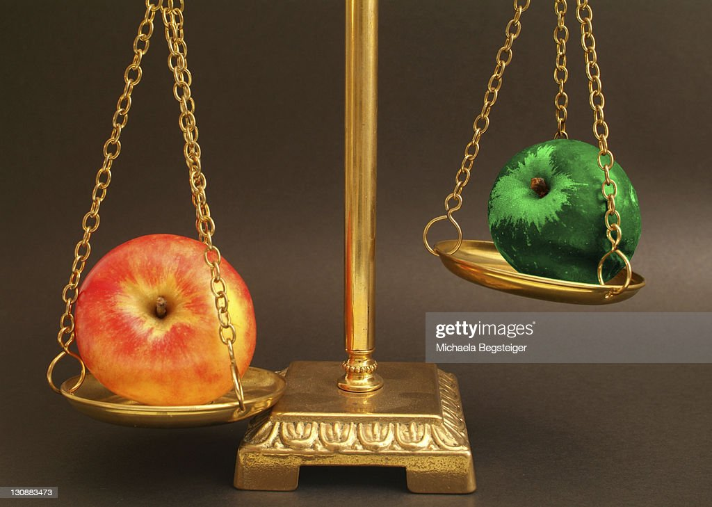Biological apple contra genetically modified apple : Stock Photo