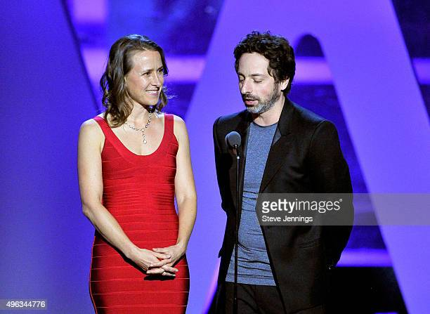 Biologist Anne Wojcicki and CoFounder Google Sergey Brin speak onstage during the 2016 Breakthrough Prize Ceremony on November 8 2015 in Mountain...