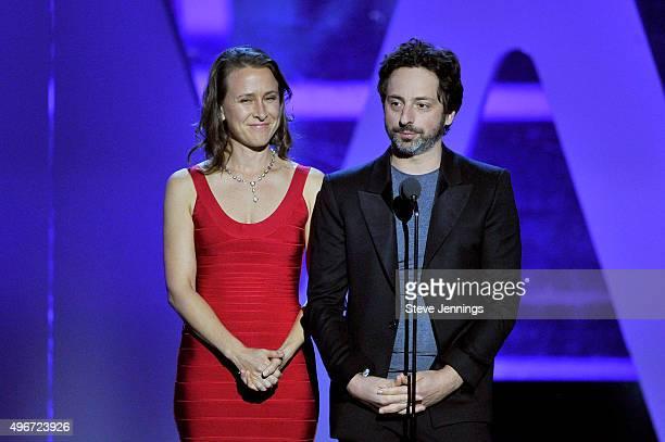 Biologist Anne Wojcicki and CoFounder Google Sergey Brin speak onstage during the 2016 Breakthrough Prize Ceremony on November 8 2015 in Mountain...