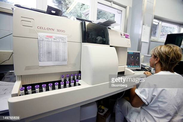 A biologist uses a CellDyn 3200 analyzer manufactured by Abbott Laboratories to test blood samples in the medical laboratory of the Casa di Cura San...