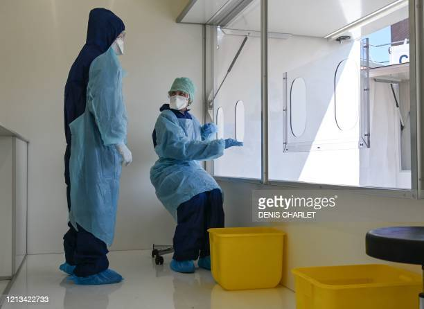Biologists of the Synlab laboratory prepare to collect samples from employees of a company at a COVID19 coronavirus testing centre in Lens northern...