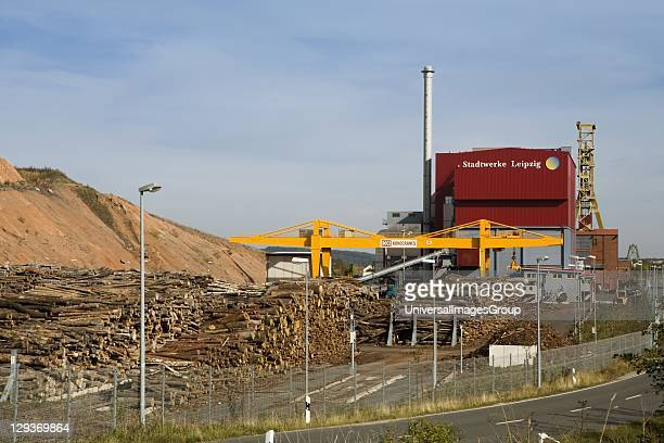 Biomass plant Bischofferode Holungen Exterior view of power station showing wood storage area gantry crane and old spoil heap from onetime potash...
