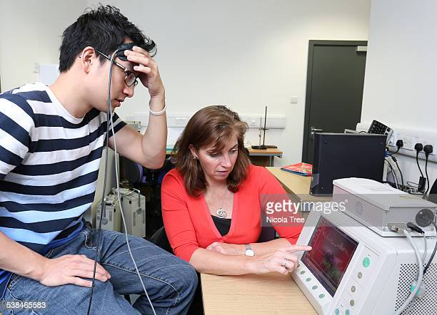 Biomedical engineer monitoring patients brain
