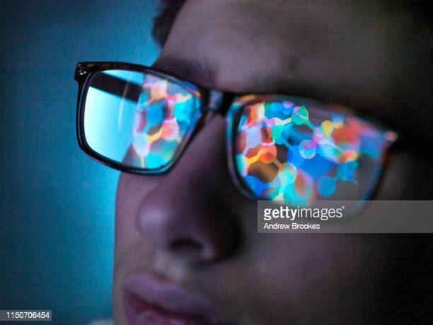 biotechnology research, computer screen reflection in spectacles of new molecular formula in laboratory, close up of face - discovery stock pictures, royalty-free photos & images