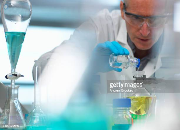 Biotechnology, scientist preparing a chemical formula during an experiment in the laboratory