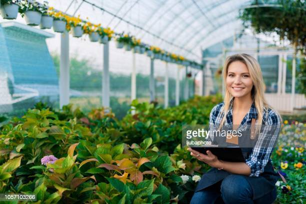 Biotechnology woman engineer examining a plant leaf for disease!