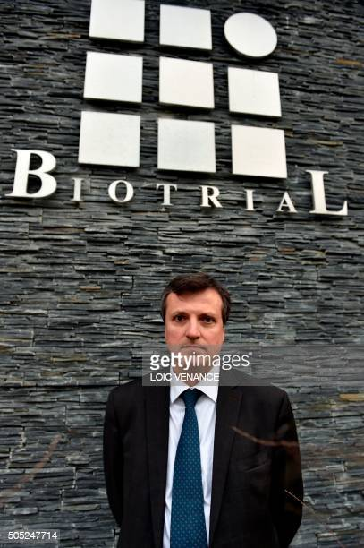 Biotrial general director Francois Peaucelle poses in front of the Biotrial logo at the society headquarters in Rennes western France on January 16...