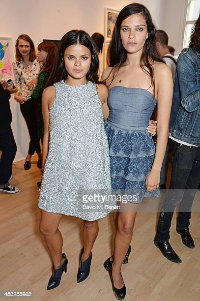 Bip Ling and Evangeline Ling attend a private view of the Fashion Illustration Gallery summer show at The Mayor Gallery on August 6 2014 in London...
