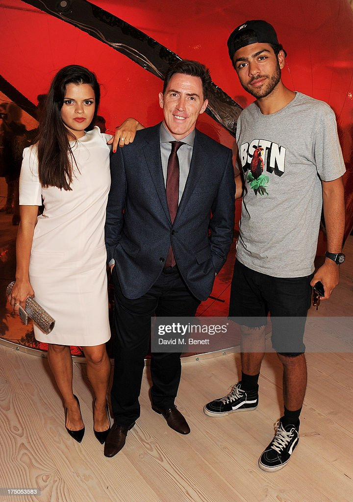 Bip Ling, Rob Brydon and Noah Becker attend a private view of 'HUGO: Red Never Follows', celebrating 20 years of Hugo Boss, at the Saatchi Gallery on July 30, 2013 in London, England.