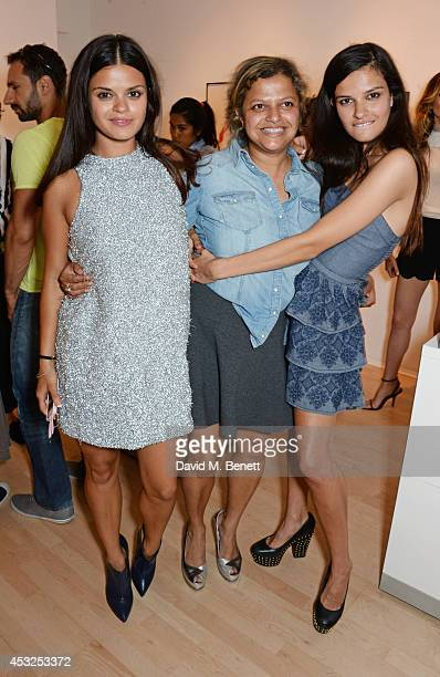 Bip Ling Tanya Ling and Evangeline Ling attend a private view of the Fashion Illustration Gallery summer show at The Mayor Gallery on August 6 2014...