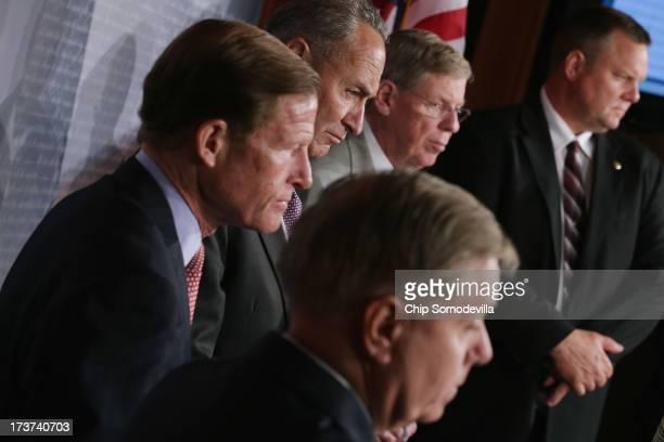 A bipartisan group of Senators including US Sen Lindsey Graham US Sen Richard Blumenthal US Sen Charles Schumer US Sen Johnny Isakson and US Sen Jon...