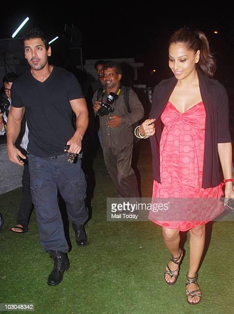 Bipasha Basu and John Abraham at the premiere of the film Khatta Meetha in Mumbai on July 22, 2010.
