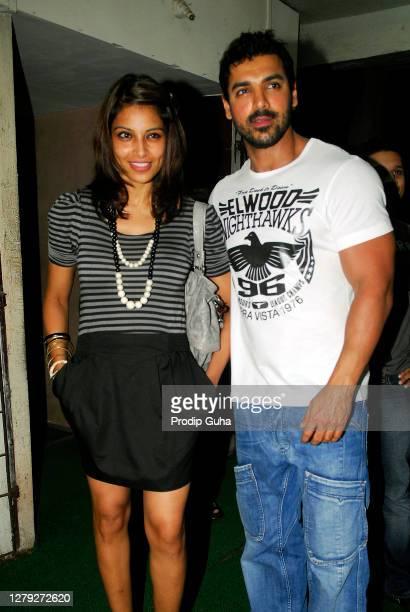 Bipasha Basu and John Abraham attend the screening of movie 'Aashayein' on August 22, 2010 in Mumbai, India