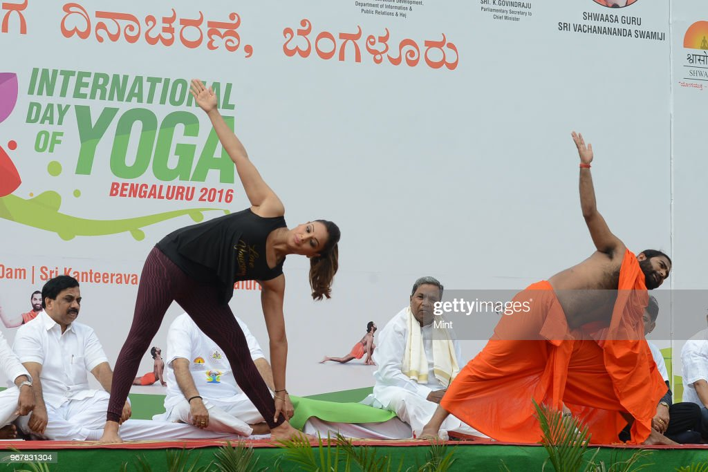 Bipasha Basu Bollywood Actress Shwaasa Guru Sri Vachananda Swamiji and Karnataka CM Siddaramaiah at Kanteerava Stadium on International Yoga Day on...