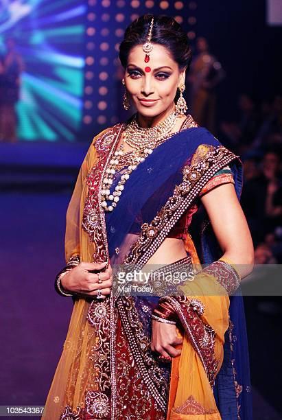 Bipasha Basu walks the ramp at the India International Jewellery week in Mumbai on August 20, 2010.