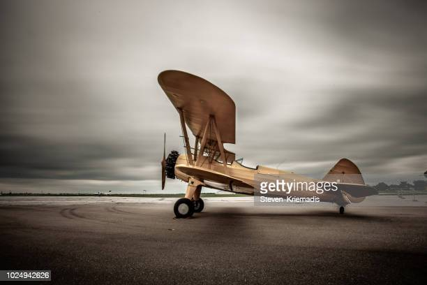 biplane - vintage airplane stock pictures, royalty-free photos & images