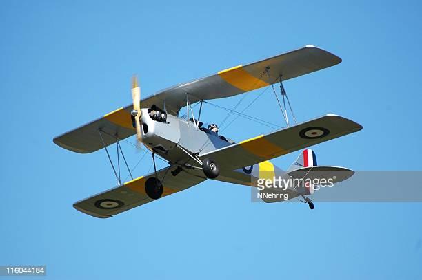 biplane R80 Tiger Moth flying in clear blue sky