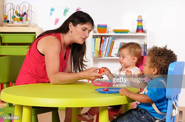Biracial Baby Boy Watches As His Peer Is given Fruit