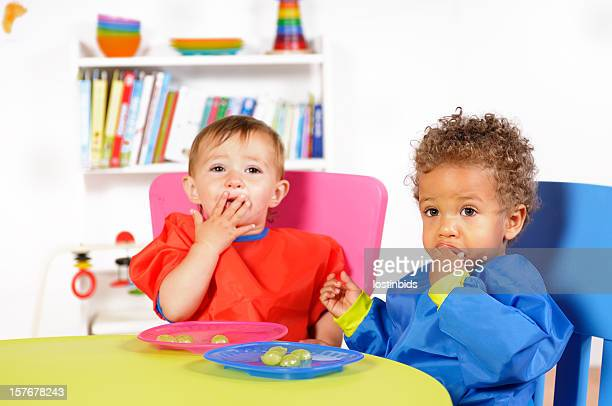Biracial Baby Boy/Toddler And Peer Eating Fresh Fruit