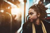 Biracial girl in a subway train