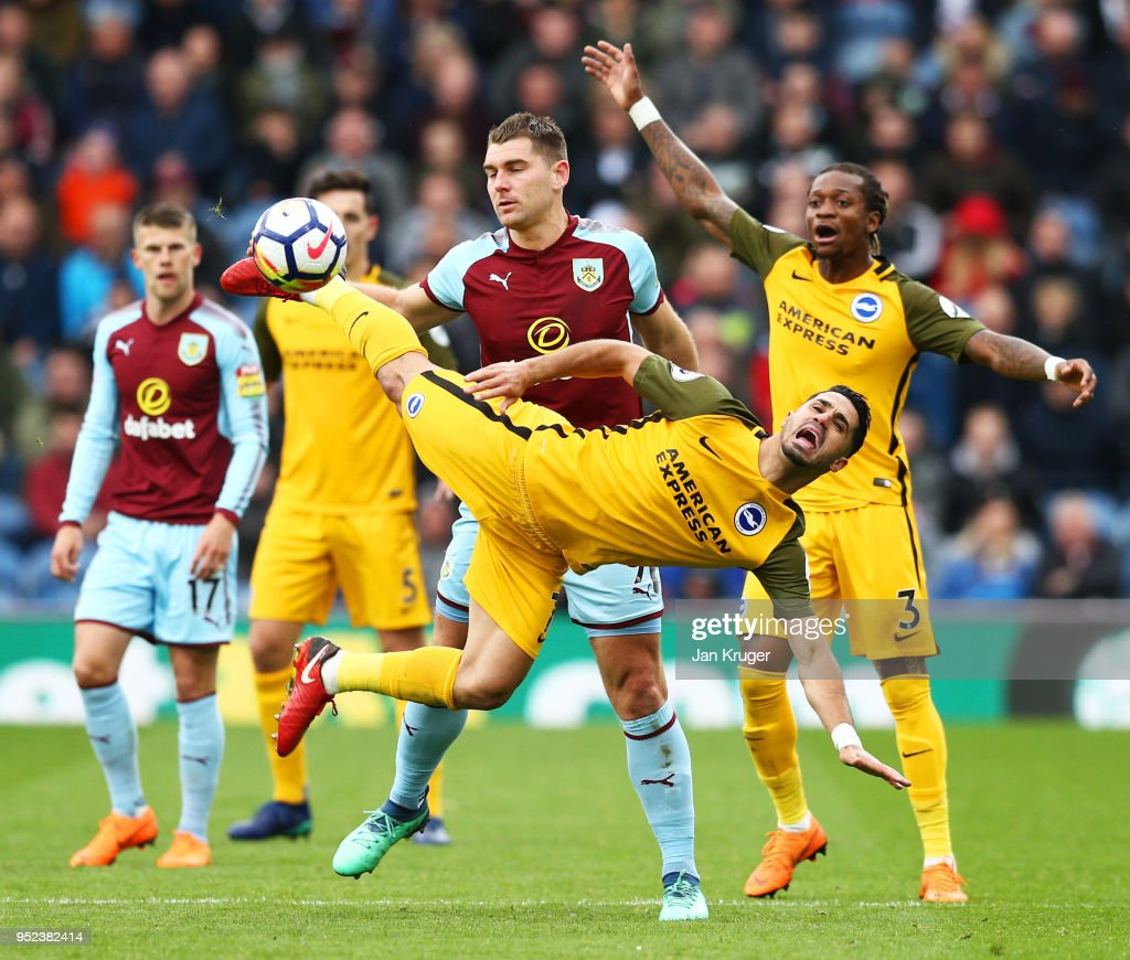 Biram Kayal of Brighton and Hove Albion is challenged Sam Vokes of Burnley during the Premier League match between Burnley and Brighton and Hove Albion at Turf Moor on April 28, 2018 in Burnley, England.