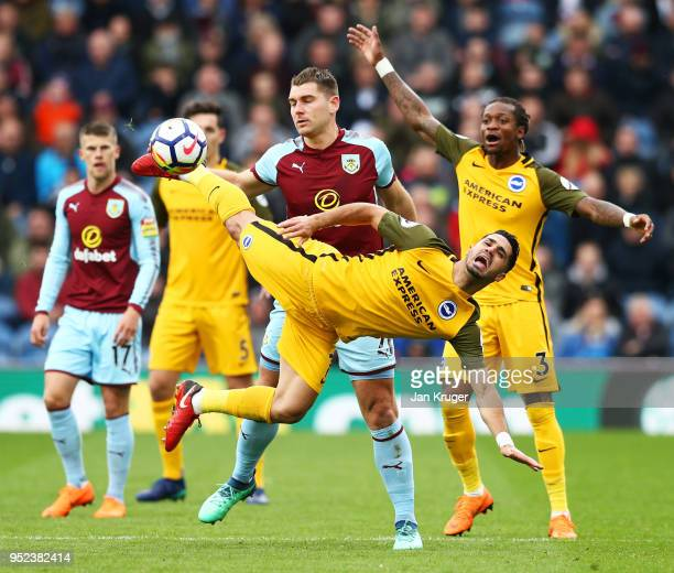 Biram Kayal of Brighton and Hove Albion is challenged Sam Vokes of Burnley during the Premier League match between Burnley and Brighton and Hove...