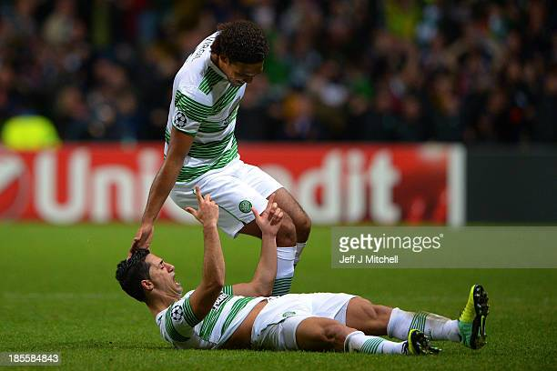Biram Kayal of Celtic is congratulated by teammate Virgil van Dijk of Celtic after scoring his team's second goal during the UEFA Champions League...