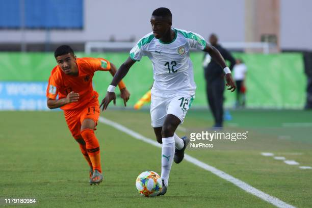Birame Diaw of Senegal and Jayden Braaf of Netherlands during the FIFA U17 World Cup Brazil 2019 group D match between Netherlands and Senegal at...