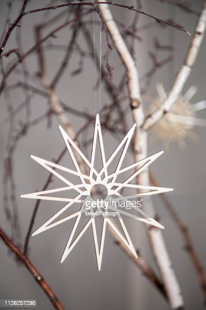 birch branches decorated with straw stars - twig stock pictures, royalty-free photos & images