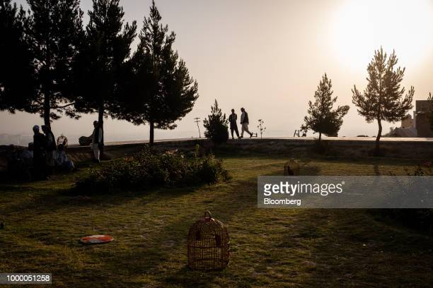 Bird cages sit on the ground as people through at the top of Bibi Mahru Hill in Kabul Afghanistan on Sunday July 15 2018 US President Donald last...