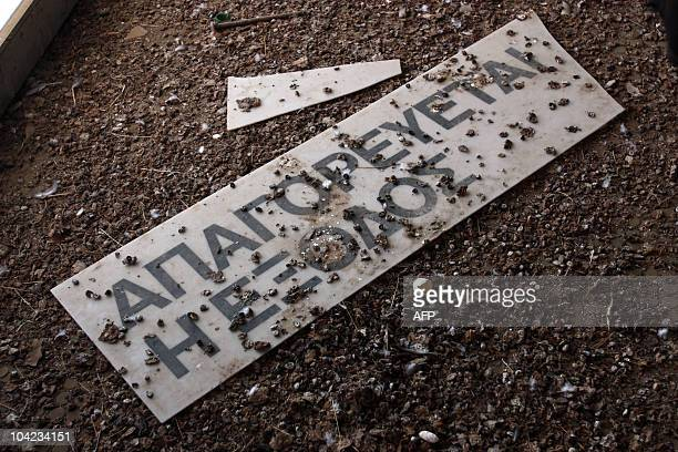 """Bird droppings cover an """"No Exit"""" sign in Greek at the old Nicosia airport terminal building, now located within the UN-controlled buffer zone that..."""