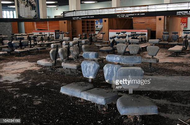 Bird droppings cover seats in a waiting room inside the old Nicosia airport terminal building, now located within the UN-controlled buffer zone that...